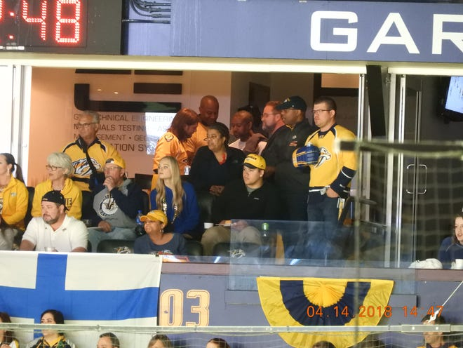 Metro employees inside a Collier Engineering's suite earlier this year for a Nashville Predators playoff game.