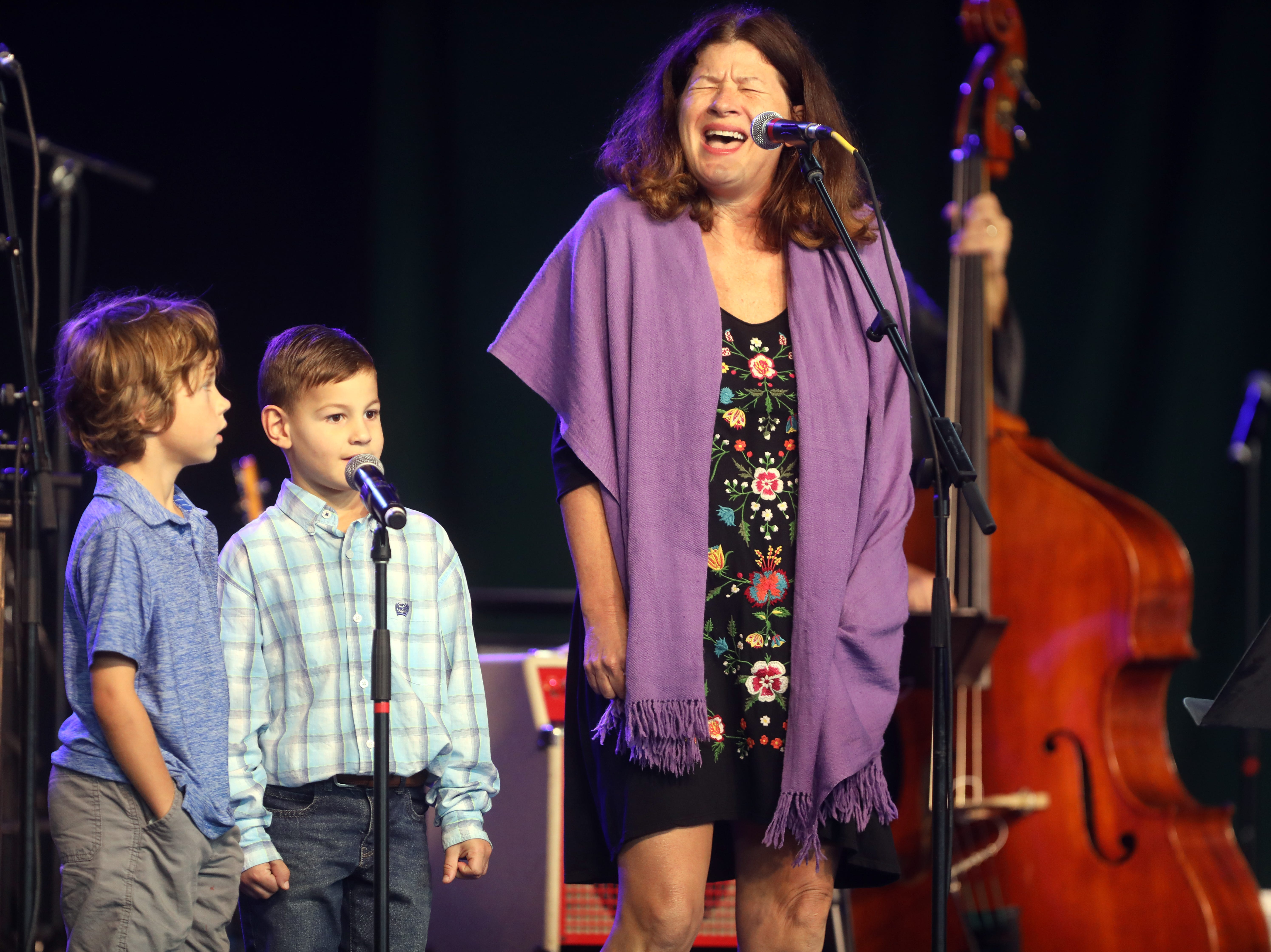 Michelle White performs with Miles White, far left, and Gus White, center, during a Celebration of Life service held for singer-songwriter Tony Joe White at Marathon Music Works Wednesday, October 31, 2018.