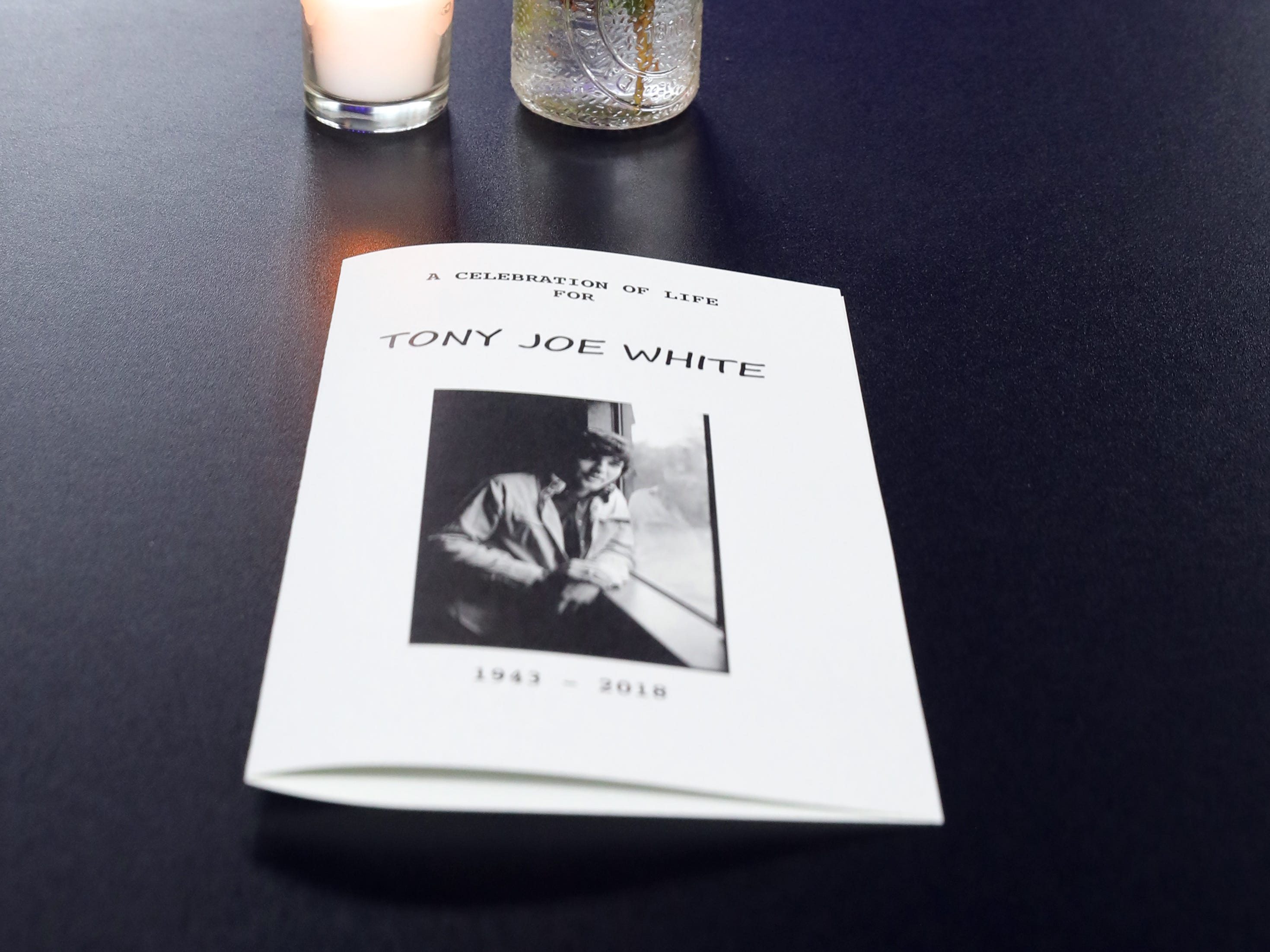 Flowers, programs and candles are set on each table during a Celebration of Life service held for singer-songwriter Tony Joe White at Marathon Music Works Wednesday, October 31, 2018.