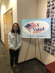 "Vy Le, 18, stands next to an ""I Voted Early"" sign at Casa Azafran, which is an early voting location for the Nov. 6 midterm election."