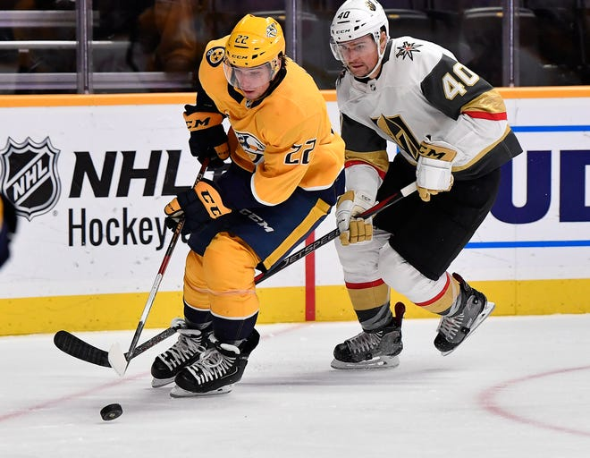Predators left wing Kevin Fiala (22) takes the puck from Golden Knights center Ryan Carpenter (40) during the second period Tuesday.