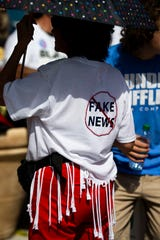 Kay Ecoff of Fort Myers wears a fake news shirt she embellished herself before a Trump rally on Wednesday, October 31, 2018, at Hertz Arena in Estero.