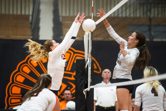 Lely High School's Colleen Ziegelmaier (9) tries to spike against Tarpon Springs during the Class 6A region semifinals at Lely High School on Tuesday. The Trojans lost in straight sets.