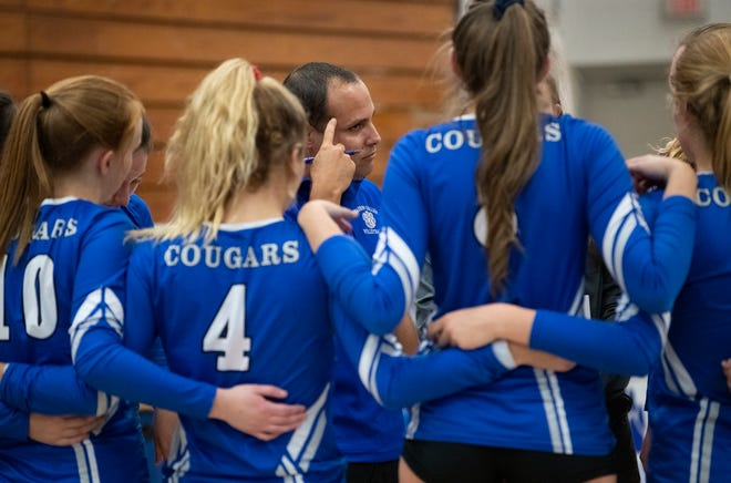Barron Collier head coach Yami Del Valle talks with his team during a timeout in the regional semifinal match against Fort Myers last week. The Cougars play Port Charlotte in the 7A regional final Tuesday night.