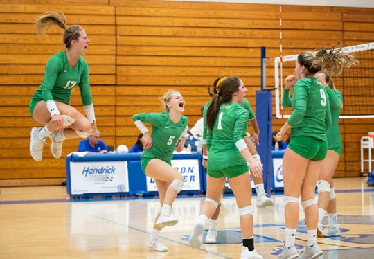 Fort Myers celebrates winning the first game of the  regional semifinal match against Barron Collier at Barron Collier High Tuesday night, October 30, 2018.