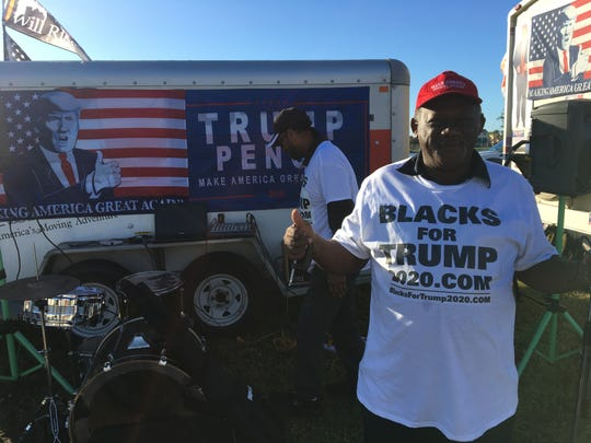 "Dale Raines of Miami wears a ""Blacks for Trump"" T-shirt as he arrives 10 hours early for President Trump's 7 p.m. rally at Hertz Arena in Estero on Wednesday, Oct. 31, 2018."