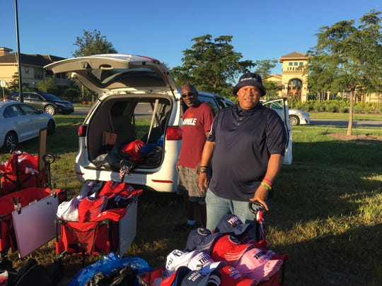 Helbert Morrison, 54 and from Washington, D.C., prepares to sell Donald Trump merchandise to fans waiting in line outside of Hertz Arena on Wednesday, Oct. 31, 2018.
