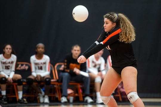 Lely High School's Theresa Keegan sets the ball during the Class 6A region semifinals at Lely High School in Naples, Fla., on Tuesday, October 30, 2018.