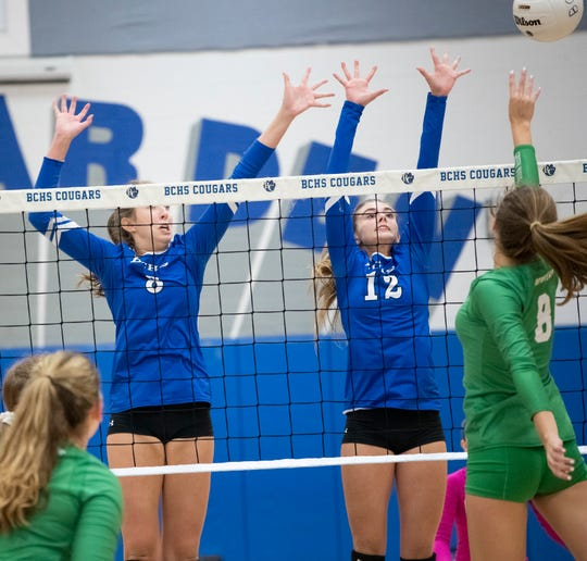 Hannah Alfes, left, and Jennifer Coxwell of Barron Collier try to block a shot by Isabella Perry of Fort Myers in the regional semifinal match last week. The Cougars play Port Charlotte for the 7A regional title on Tuesday night.