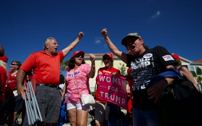 Donald Trump supporter Donna Renfroe shouts support for the president before a Make America Great rally at Hertz Arena on Wednesday, Oct. 31, 2018.