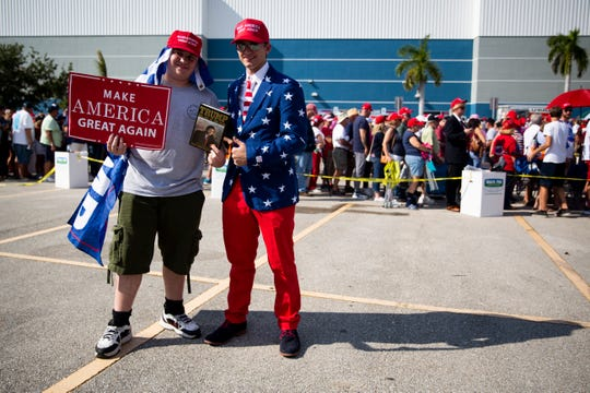 Chris Swanson, left, and Dave Mikolajczak, right, pose for a portrait before a Trump rally on Wednesday, October 31, 2018, at Hertz Arena in Estero.