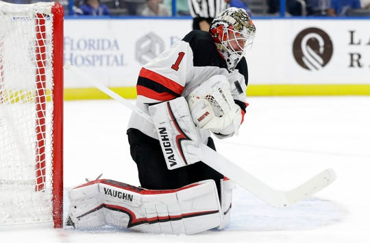 New Jersey Devils goaltender Keith Kinkaid makes a save on a shot by the Tampa Bay Lightning during the second period of an NHL hockey game Tuesday, Oct. 30, 2018, in Tampa, Fla.