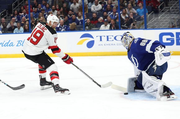 New Jersey Devils center Travis Zajac (19) shoots and scores a goal on Tampa Bay Lightning goaltender Andrei Vasilevskiy (88) during the first period at Amalie Arena.