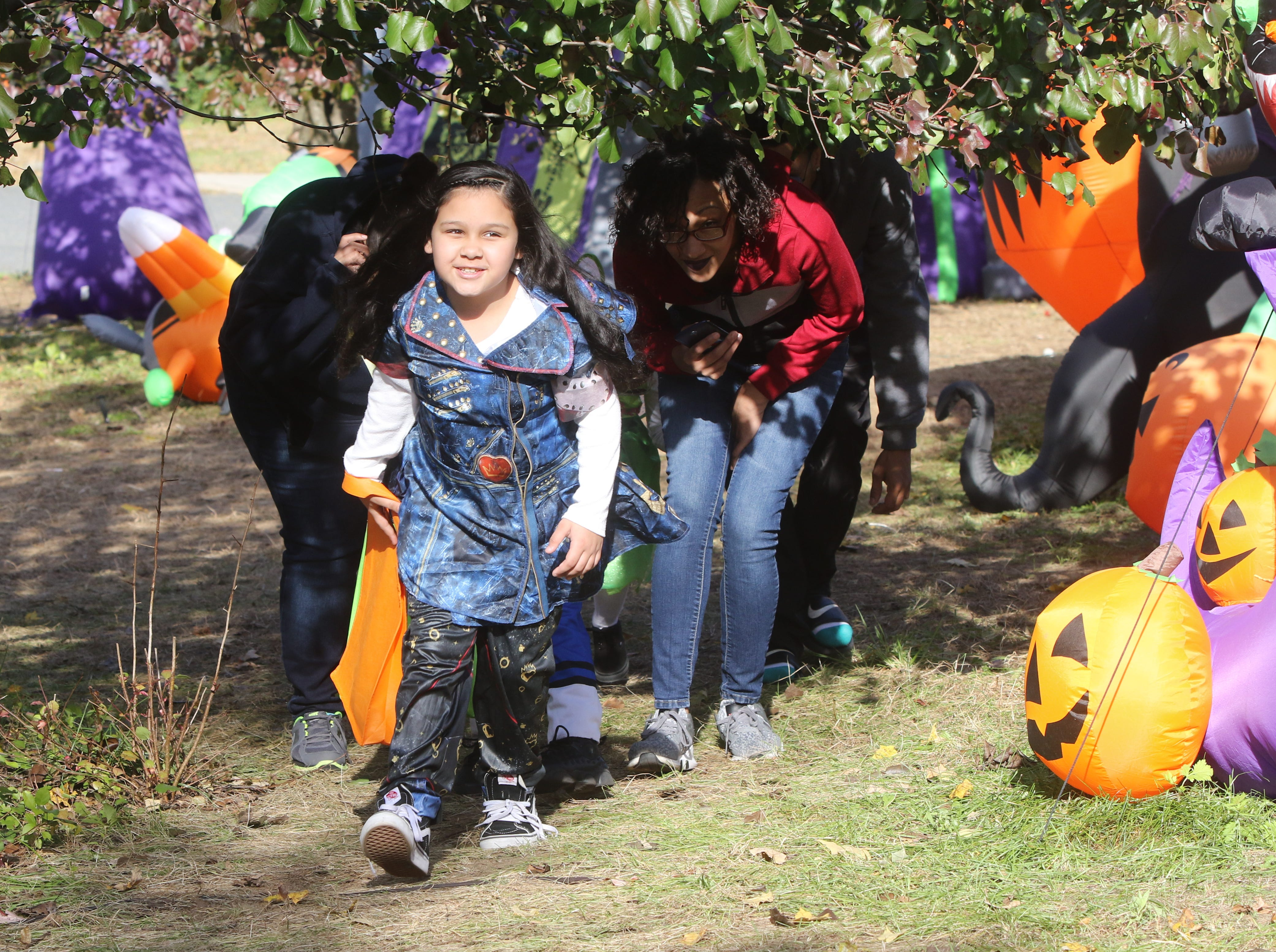 Here, Ailahni Rodriguez 9 of Passaic makes her way through the maze of Halloween displays. 