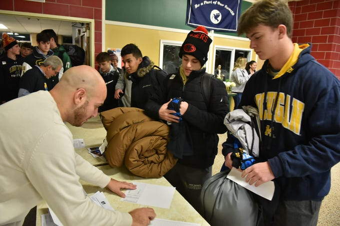 Students check in to participate in Covenant Sleepout in Montvale. Members of the St. Joe's student body and faculty raise money for the North Jersey chapter of Covenant House by spending the night out.