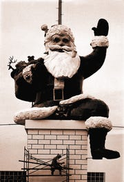 "1974: ""Santa's little helper"" puts on the finishing touches on Santa's chimney at the Garden State Plaza, Paramus."
