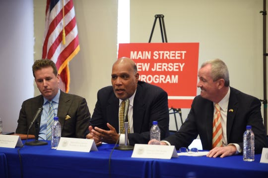 Montclair Mayor Robert Jackson speaks about Main Street NJ and neighborhood preservation as Essex County Freeholder Brendan Gill, Gov. Phil Murphy and other officials listen during the round table discussion at Montclair Fire Headquarters in Montclair on 4/12/18.
