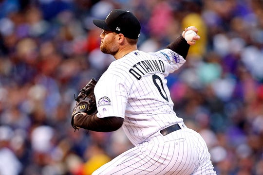 Oct 7, 2018; Denver, CO, USA; Colorado Rockies relief pitcher Adam Ottavino (0) pitches during the seventh inning against the Milwaukee Brewers in game three of the 2018 NLDS playoff baseball series at Coors Field.