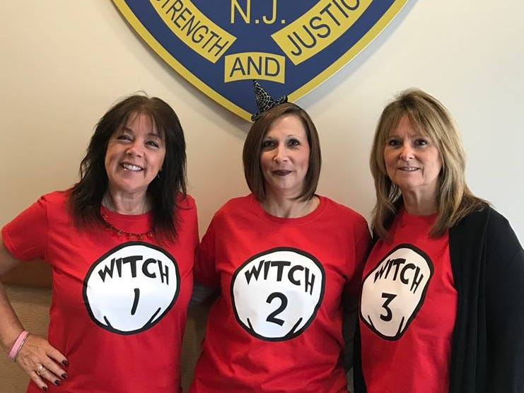 Wanaque records clerk and witch 1 Kim DeVore, dispatcher and witch 2 Cheryl D'Amelio Verrone, and administrative assistant witch 3 Linda Westervelt get in the Halloween spirit.