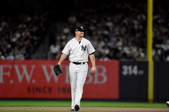 New York Yankees pitcher Zach Britton (53) reacts after missing a play on the ball allowing a Boston Red Sox running to get to first in Game 4 of the American League Division Series on Tuesday, Oct. 9, 2018, in New York.