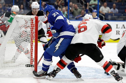 Tampa Bay Lightning center Brayden Point (21) beats New Jersey Devils defenseman Andy Greene (6) to the puck for a goal during the second period of an NHL hockey game Tuesday, Oct. 30, 2018, in Tampa, Fla.