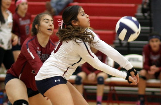 Senior libero Kianna Gomez worked the passing game Tuesday night against the Mayfield Trojans. Backing up the play is sophomore Kaydance Chavez at left.