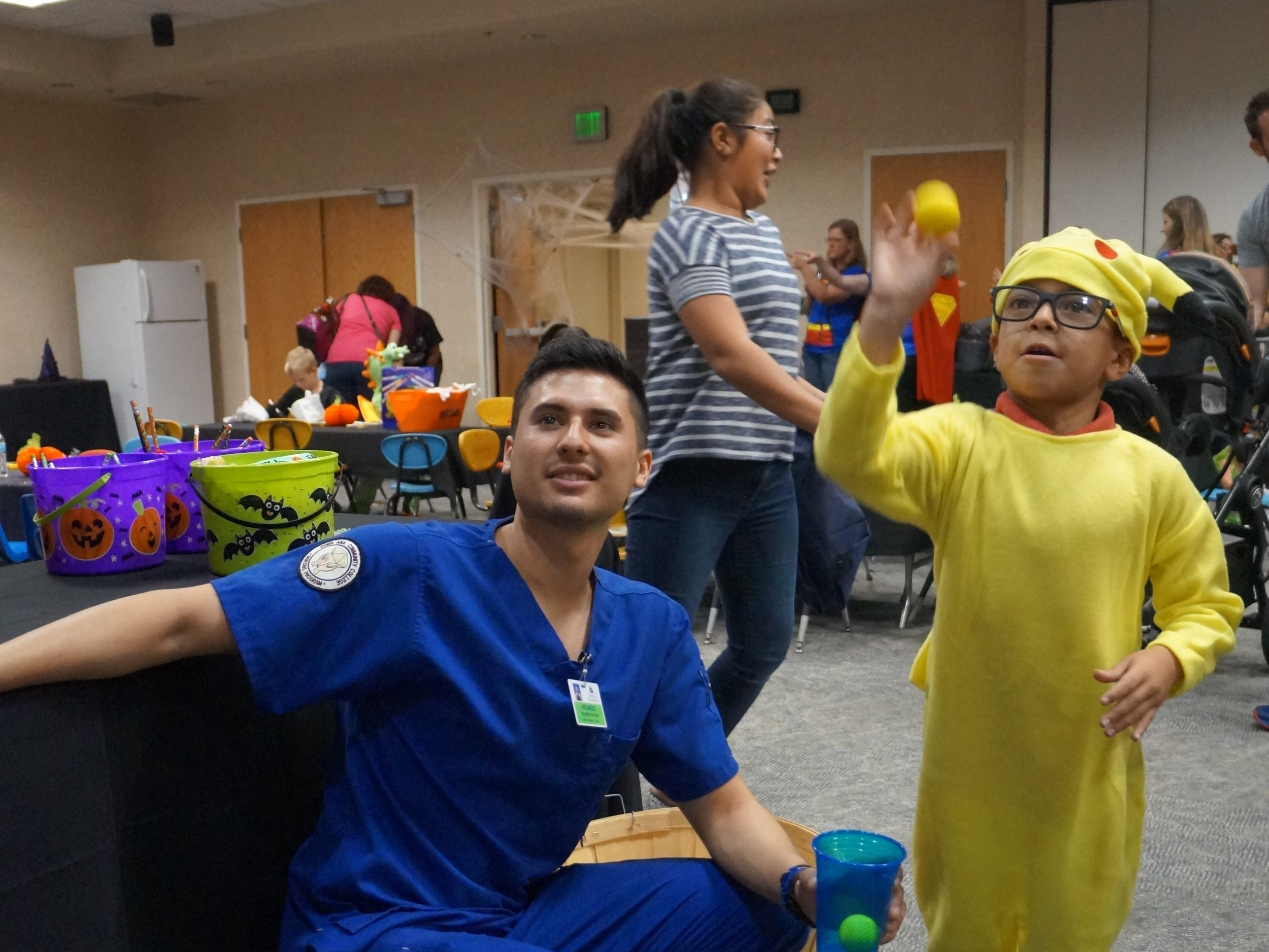 Johnny Ramos (as Pikachu) and a Doña Ana Community College nursing student play during the NICU Reunion Carnival at Memorial Medical Center. The hospital was host to a reunion of children who had been helped by the hospital's neonatal intensive care unit. Children came dressed in costume for the second NICU Reunion Carnival, held Tuesday, Oct. 30. The children, parents and hospital staff enjoyed food and games for the afternoon.