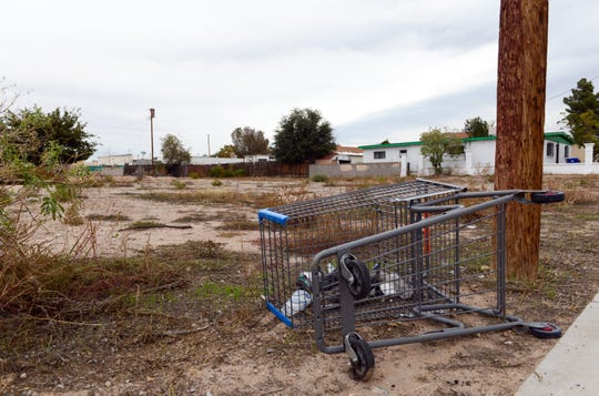 A shopping cart is discarded on a vacant lot on May Avenue in Las Cruces.