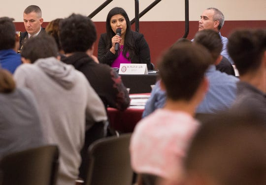 Rosa Bañuelos, the business and development and media relations officer at Spaceport America, talks with students at the Hispanic Heritage Foundation STEM event at New Mexico State University, Wednesday October 31, 2018.