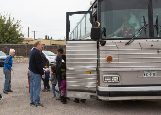 Pastor George Miller, left,  and other volunteers welcome a group of newly arrived asylum seekers at El Calvario United Methodist Church, Tuesday, October 30, 2018.