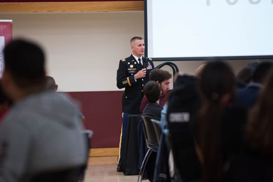 Lt. Col. Wes Childs, professor of military science and NMSU ROTC commander, talks with students at the Hispanic Heritage Foundation STEM event at New Mexico State University, Wednesday October 31, 2018.