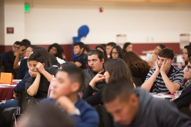 Students from the Gadsden Independent School District listen to speakers at the Hispanic Heritage Foundation STEM event at New Mexico State University on Wednesday, Oct. 31, 2018.