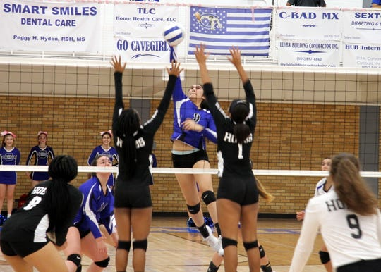 Serena Rodriquez splits two Hobbs defeners during Tuesday's match against Hobbs.