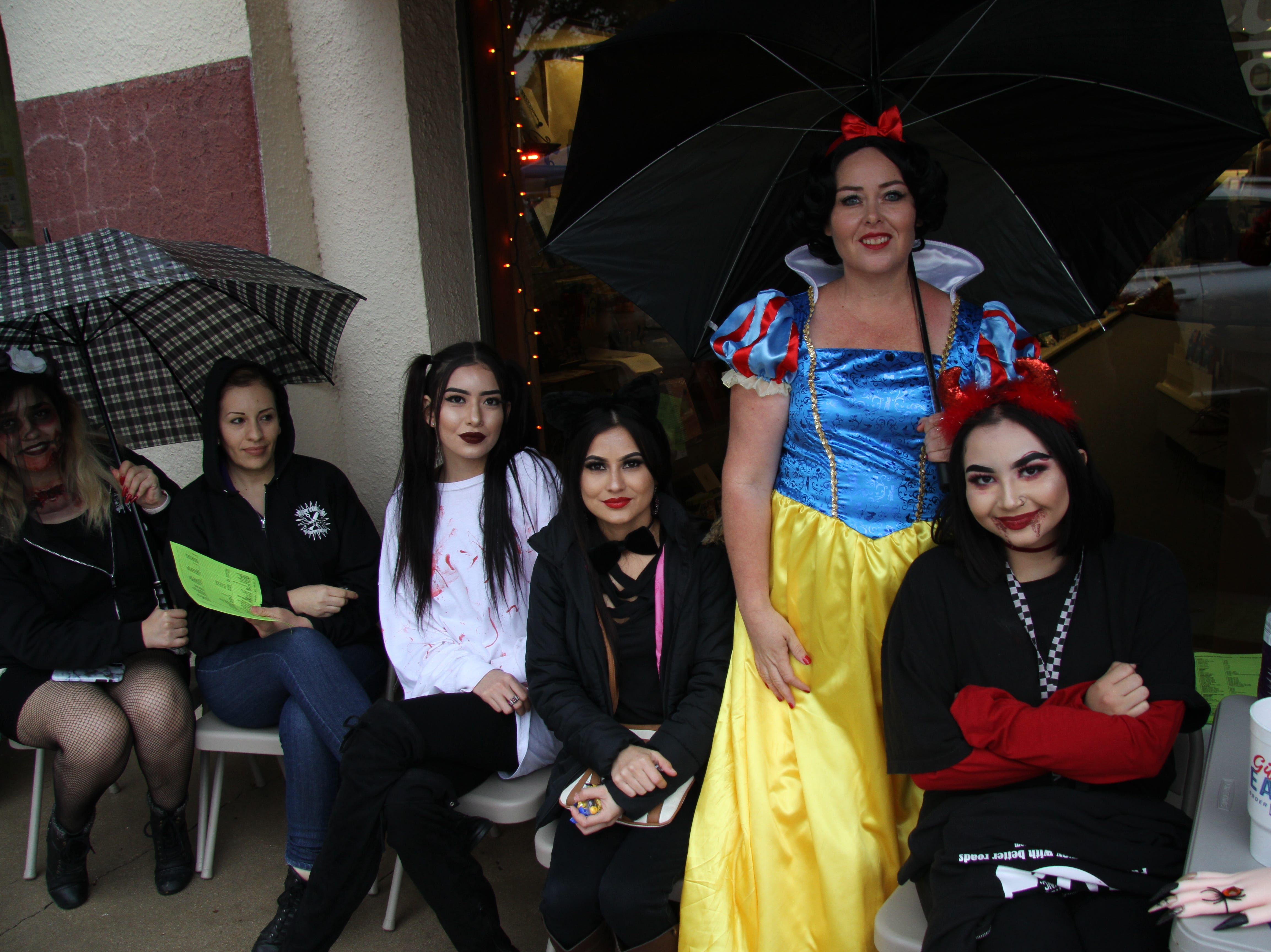 Members of The Beauty College of Eddy County brave the rainy Halloween weather during MainStreet's Fall Festival.