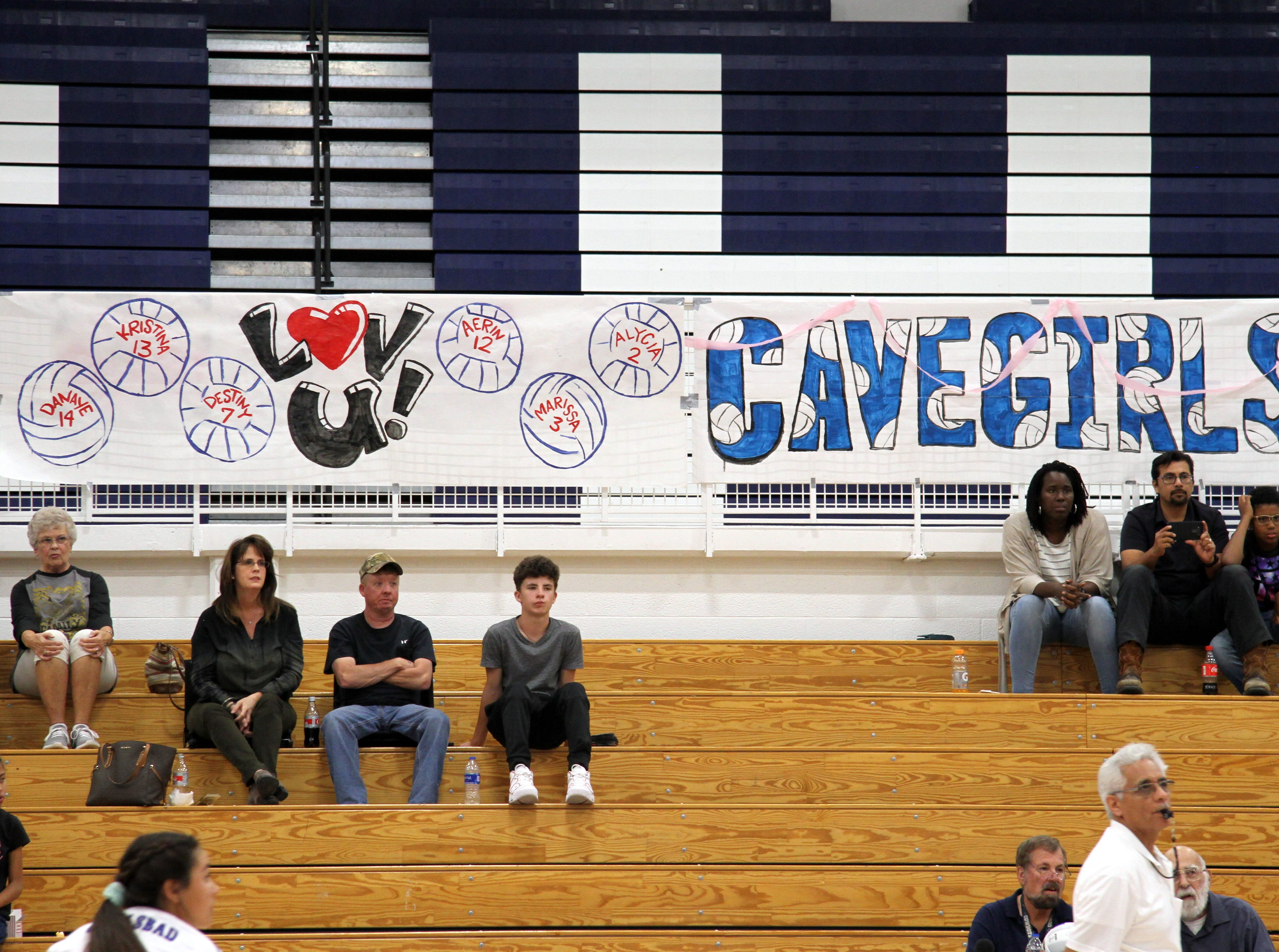 A banner with all the senior Cavegirls named hands in The Cave during Tuesday's match against Hobbs.