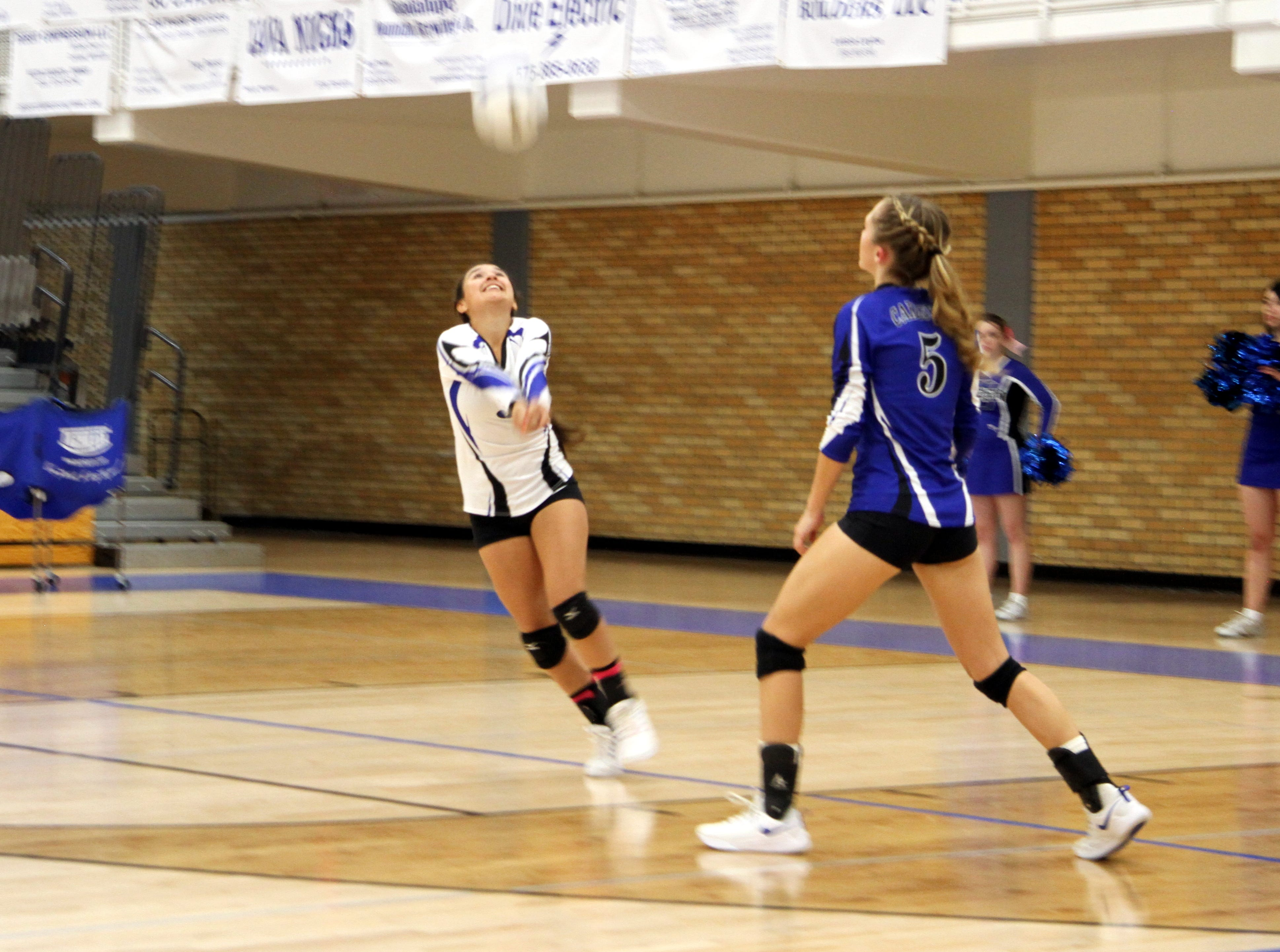 Marissa Reyes goes for a dig during Tuesday's match against Hobbs.