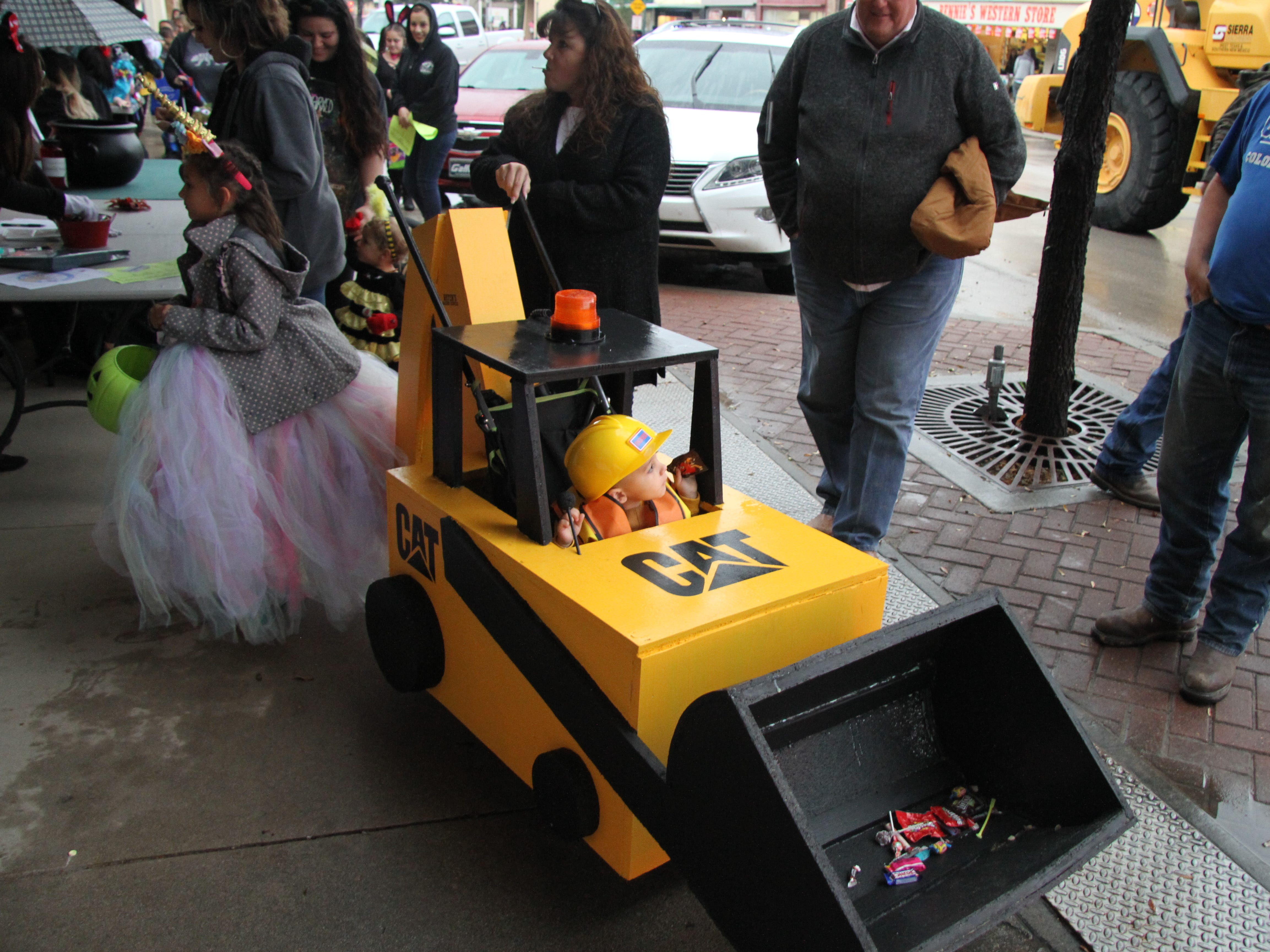 A future heavy equipment operator makes his way during Carlsbad MainStreet's Fall Festival Halloween afternoon.