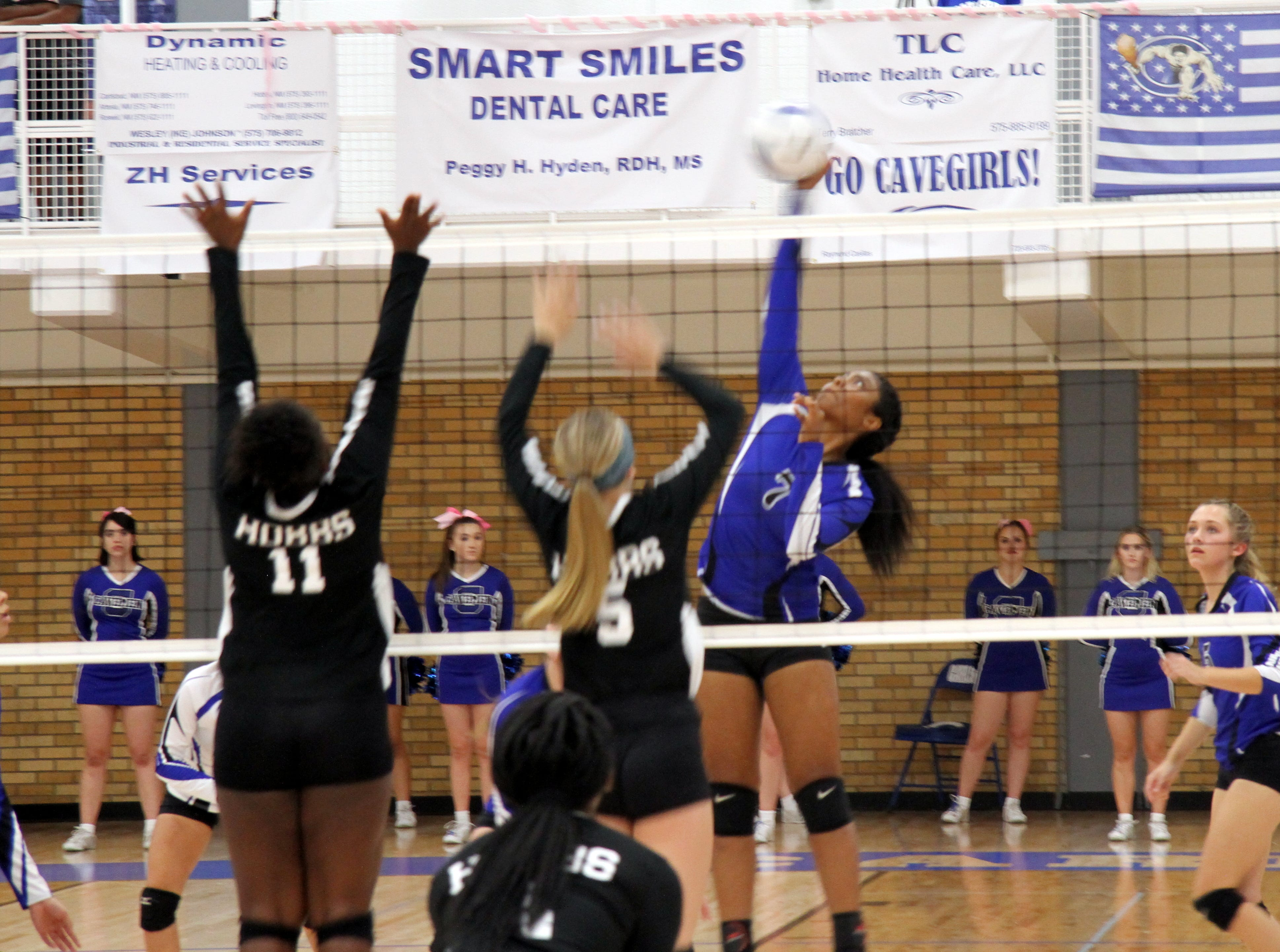 Destiny Young goes for a spike during Tuesday's match against Hobbs.