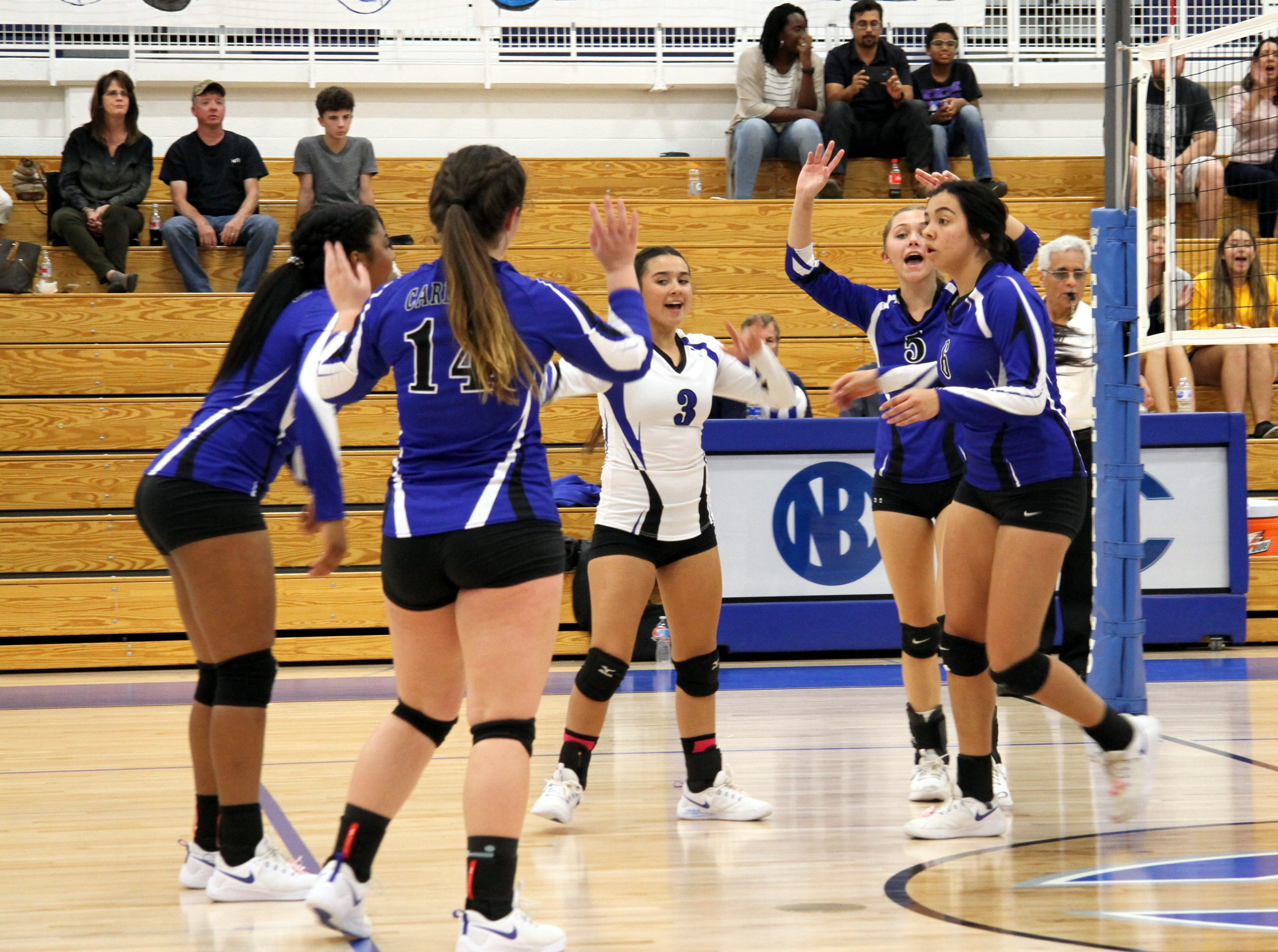 The Cavegirls celebrate winning a point in the second set of Tuesday's match against Hobbs.