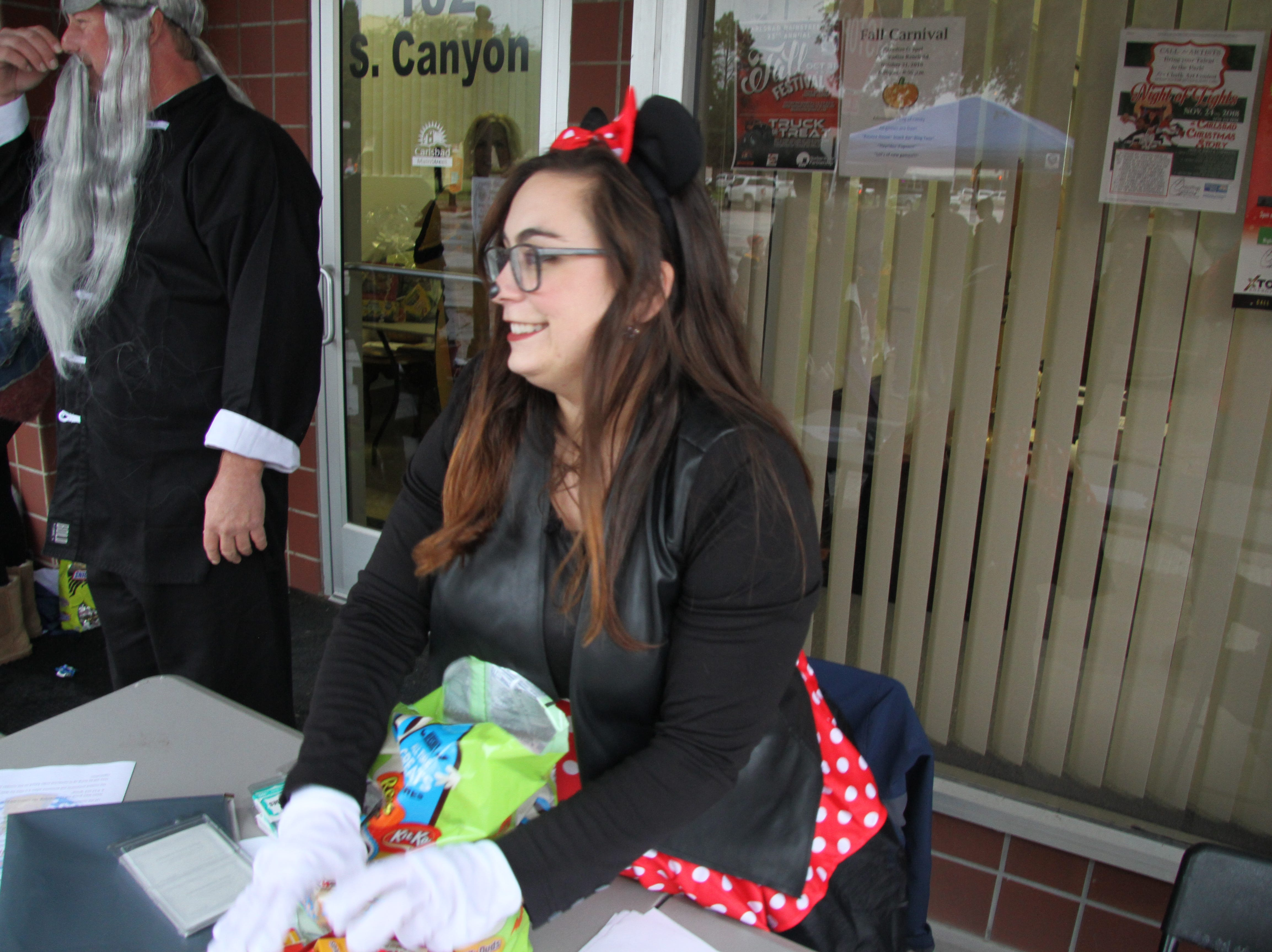 Shannon Carr of the Carlsbad Department of Development gets ready to pass out candy to trick-or-treaters during Halloween's Fall Festival.