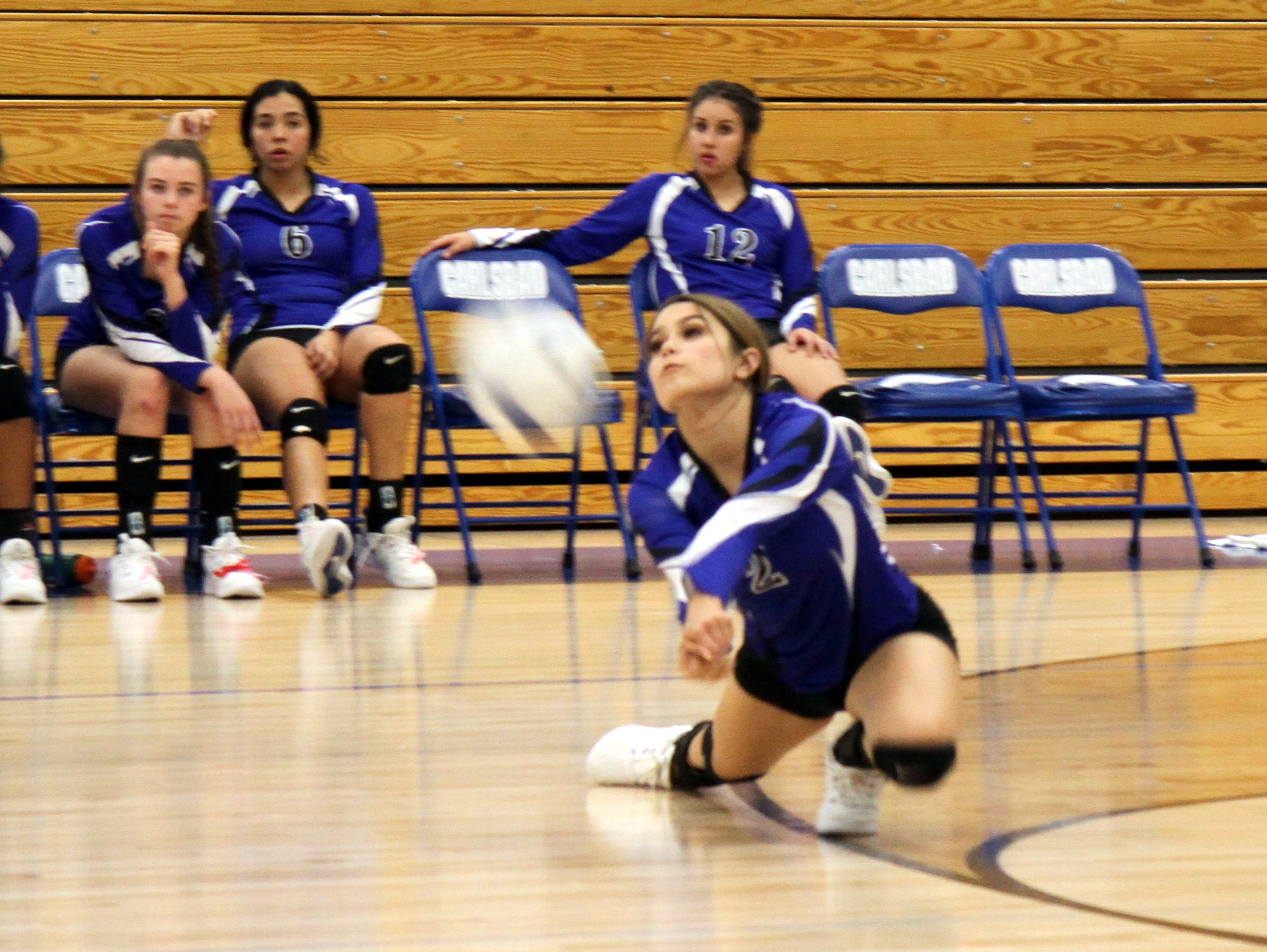 Alycia Cruz dives to save a ball during Tuesday's match against Hobbs.