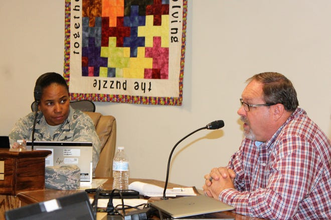APS Chief of Staff Doyle Syling, right, addresses the school board as APS Holloman Ex-Officio Member Col. Rashòne Tate, left, listens at the regular school board meeting Oct. 17. Syling was presenting information about the district's 44 expulsion hearings for the 2017-2018 school year.