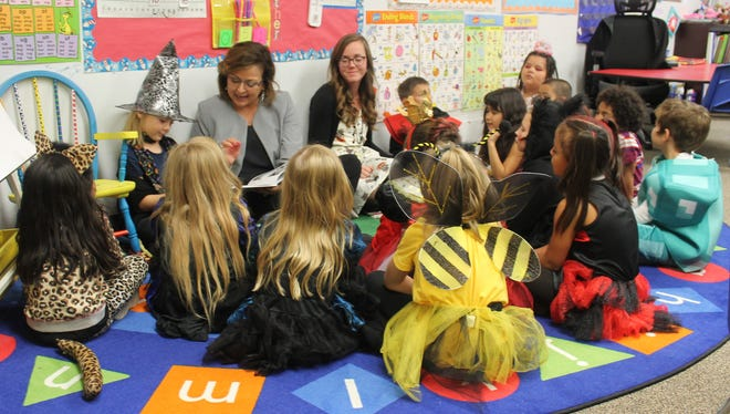 New Mexico Governor Susana Martinez stopped in Alamogordo on Wednesday afternoon to congratulate Alamogordo teacher Kimberly Landry, center, for her role in recruiting New Mexico teachers to act as liaisons between schools and the New Mexico Public Education Department.