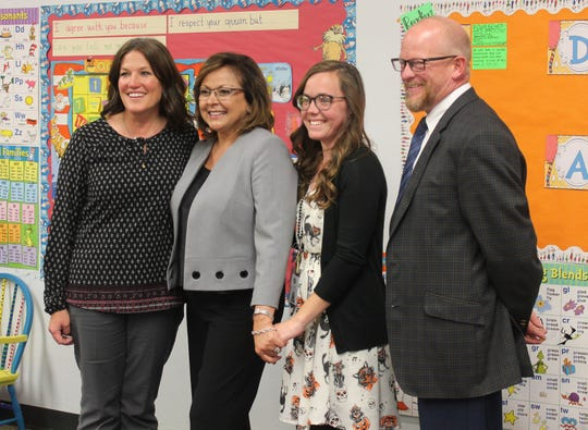 North Elementary School first grade teacher Kimberly Landry for recruiting 14 teachers to be part of the Teacher Leader School Liaison Program, which communicates information between the state and local districts. From left to right, North Elementary School Principal Amber Carroll, New Mexico Governor Susana Martinez, Kimberly Landry, and Alamogordo Public School District Acting Superintendent Jerrett Perry.