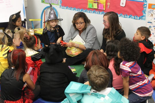 After congratulating Landry, Governor Martinez read the first graders a story and passed out Halloween candy.