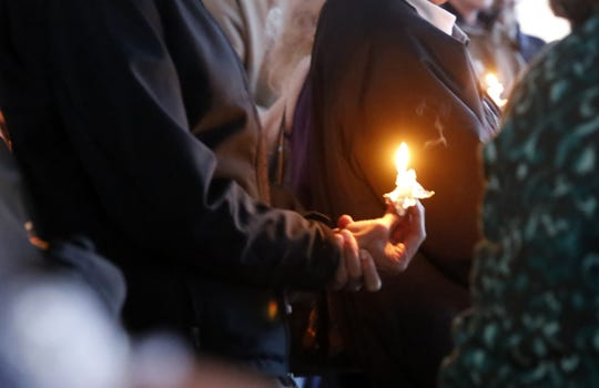 A candlelight vigil Tuesday in Orchard Park in Farmington gave local residents a chance to honor the 11 people killed Saturday during a shooting at the Tree of Life synagogue in Pittsburgh.
