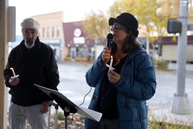 Event organizer Laura Marshall gives a speech Tuesday during a vigil in Orchard Park in Farmington to honor the 11 people who were killed Saturday during a shooting at a synagogue in Pittsburgh.