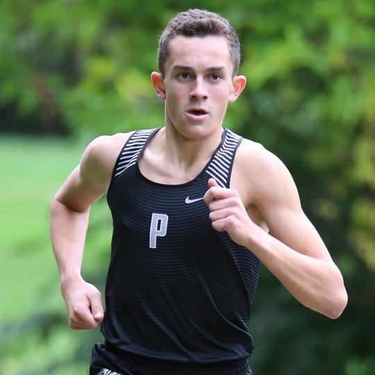 Carter Solomon's determination is evident as he chases cross country excellence for the Plymouth Wildcats.