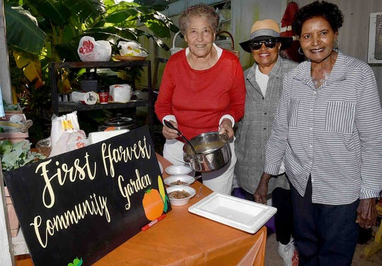 Eva Iford, Marie Marcil and Hellen Frank visit First Harvest Community Garden on Make A Difference Day.