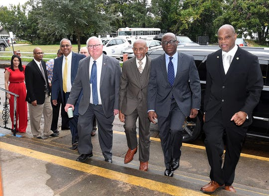 Mayor Reggie Tatum recently held a press conference to announce new business opportunities for the city of Opelousas. He is pictured with other dignitaries as they arrive at Opelousas City Hall.